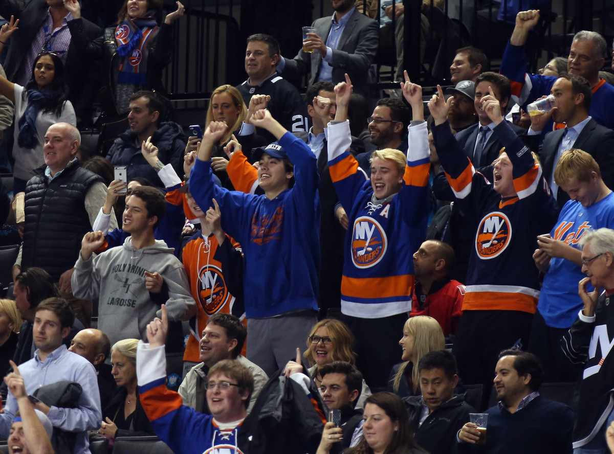 New York Islanders fans celebrate a goal with a chant. (Photo: Bruce Bennett/Getty Images)