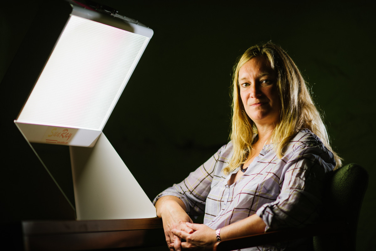 Clinical psychologist Kelly Rohan sits in front of a light box. (Photo: Andy Duback)