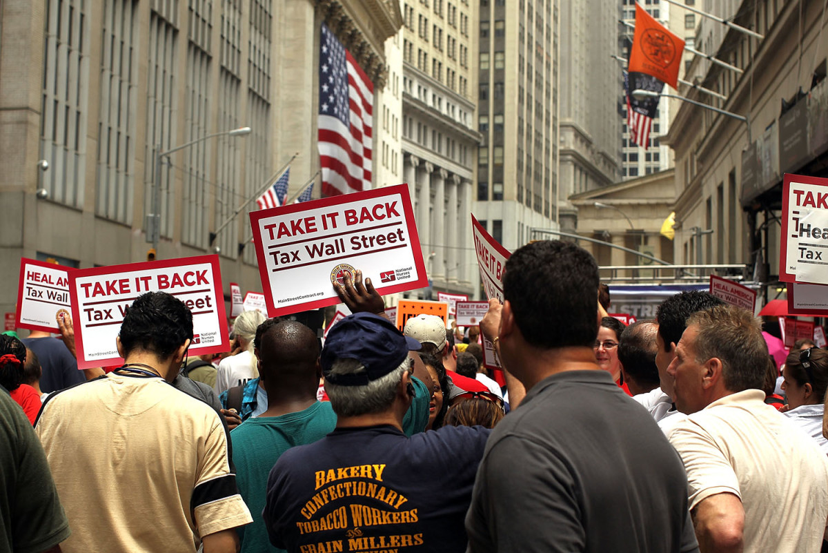 Workers converge on Wall Street to protest against financial institutions and inequality on June 22, 2011, in New York City. (Photo: Spencer Platt/Getty Images)