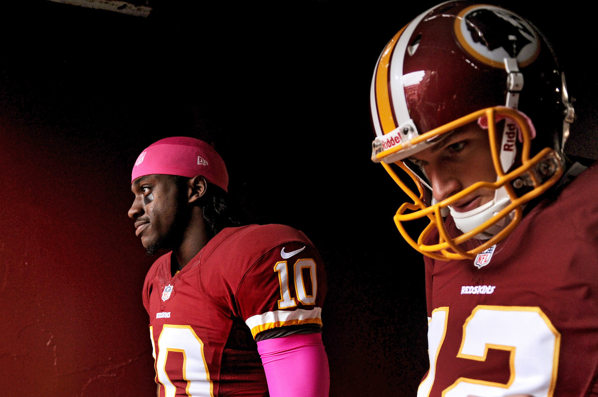 Quarterbacks Robert Griffin III (L) and Kirk Cousins of the Washington football team take the field before playing the Atlanta Falcons at FedExField in 2012, back when Griffin was still the team's starter. (Photo: Patrick Smith/Getty Images)