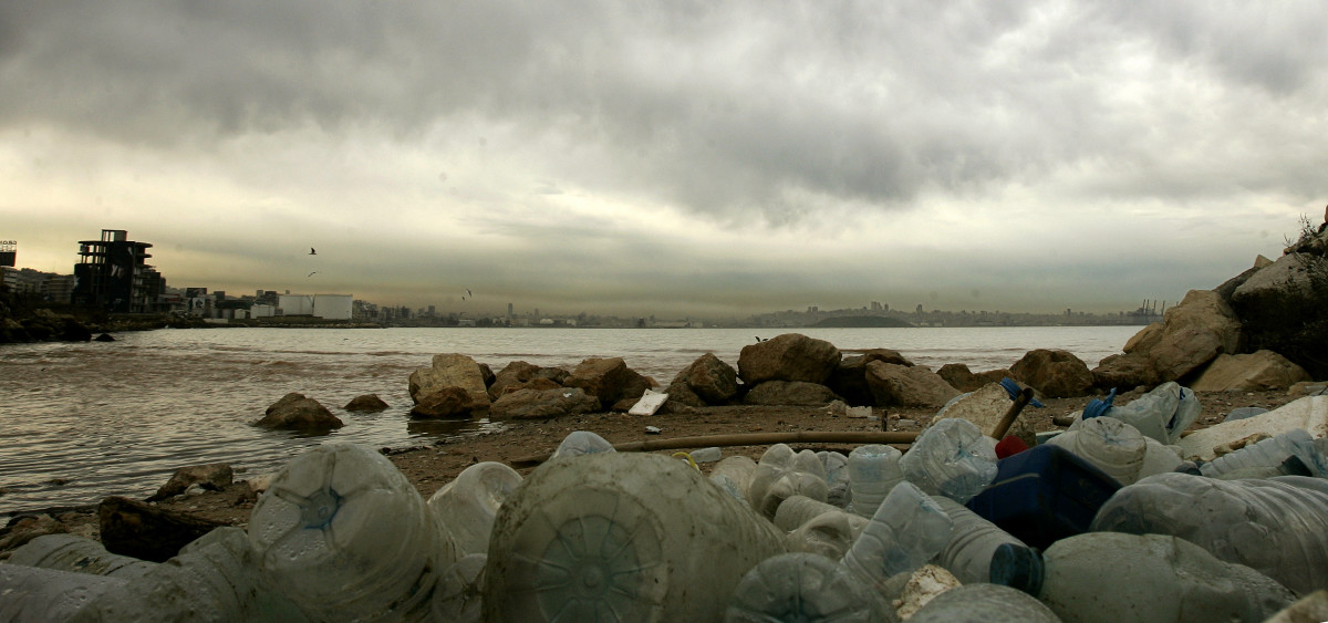 Smog covers the skyline of Beirut while empty plastic bottles and trash  pollute the shore of the Mediterranean off Dbayeh, a suburb of the  Lebanese capital. (Photo: Joseph Eid/AFP/Getty Images)