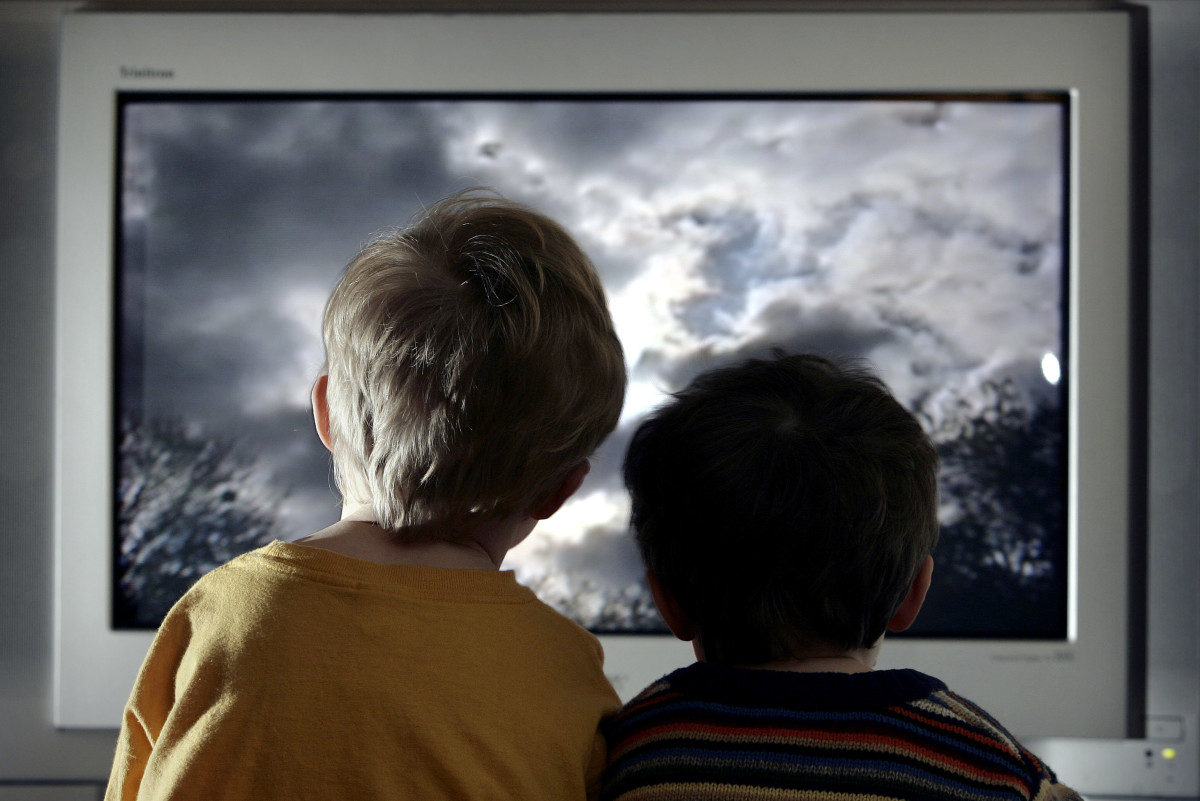 In this photo illustration two young child watch television at home in London, England. (Photo: Peter Macdiarmid/Getty Images)