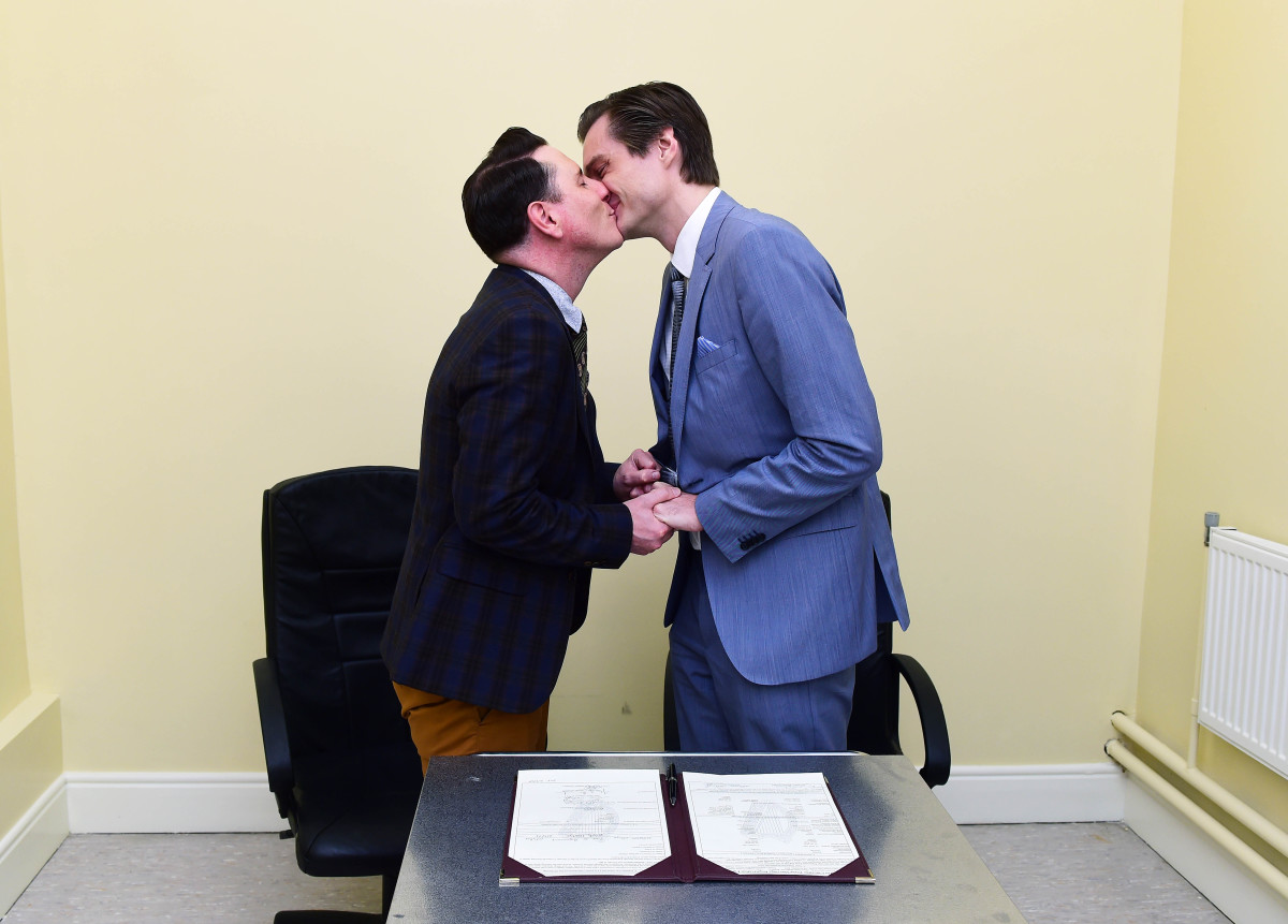 Newly married couple Richard Dowling and Cormac Gollogly kiss after the first same-sex marriage takes place on November 17, 2015, in Clonmel, Ireland. (Photo: Charles McQuillan/Getty Images)