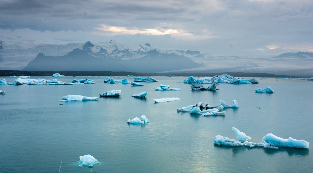 Luminous blue icebergs floating in Jokulsarlon glacial lagoon at dusk, Iceland. (Photo: Anna Morgan/Shutterstock)