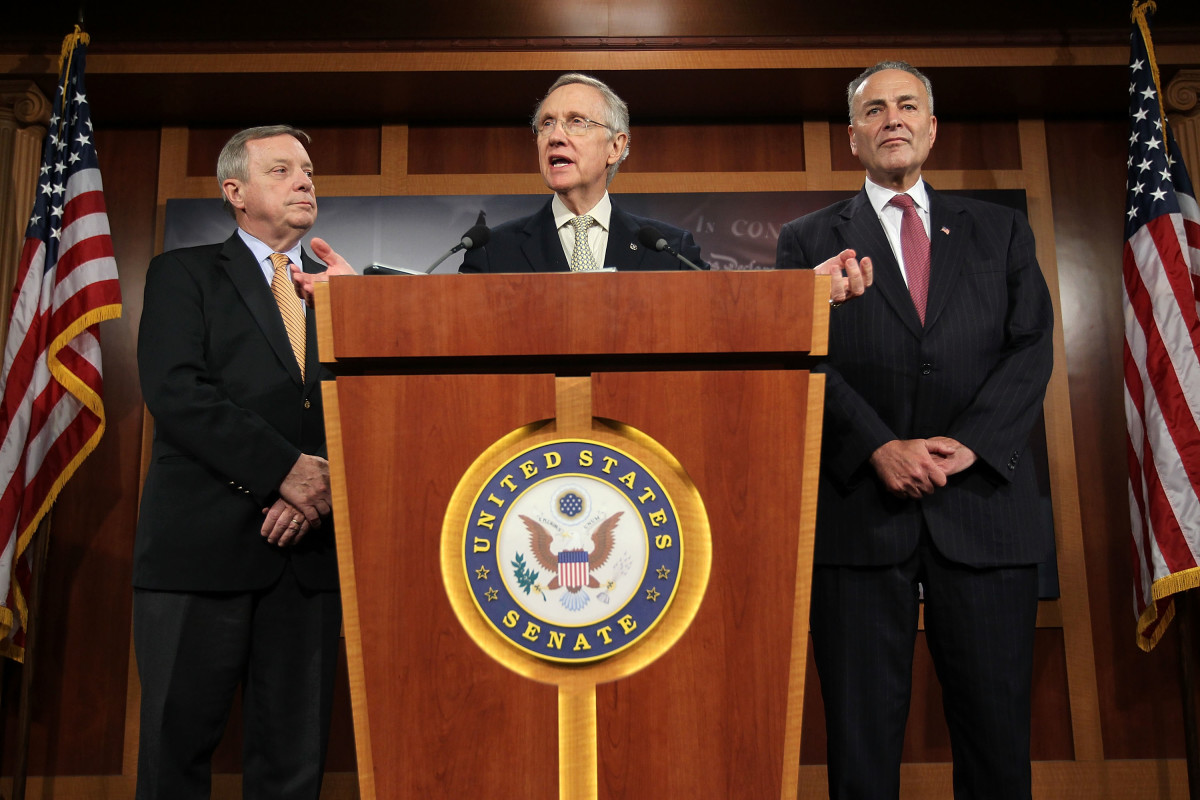 U.S. Senate Minority Leader Harry Reid (center) speaks as Senate Majority Whip Richard Durbin (left) and Senator Charles Schumer listen during a news conference at the Capitol in Washington, D.C. (Photo: Alex Wong/Getty Images)