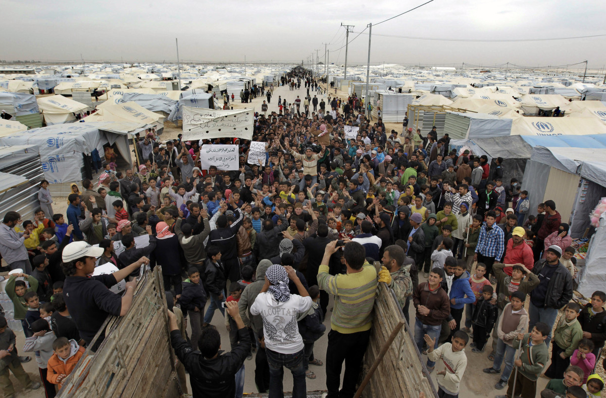 Syrian refugees take part in a demonstration at the Zaatari refugee  camp, near the border with Syria. (Photo: Khalil Mazraawi/AFP/Getty Images)