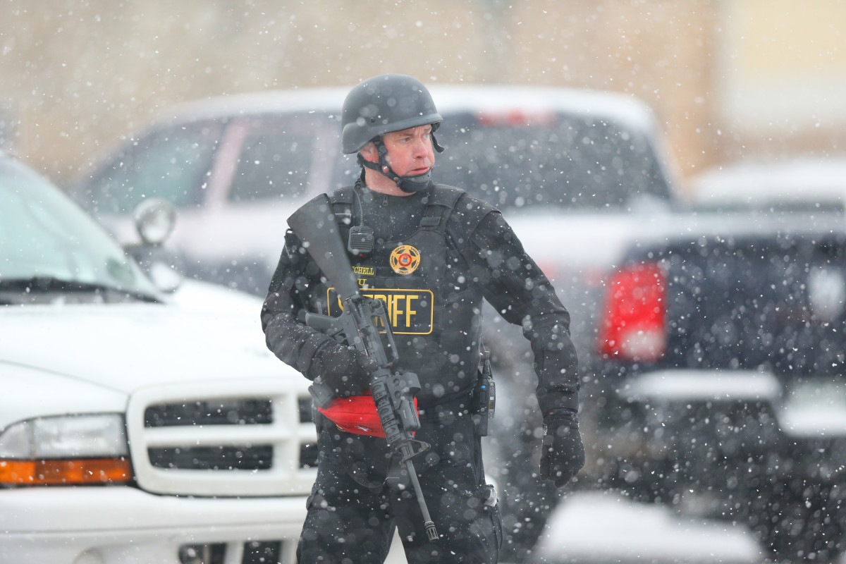 A member of the Colorado Springs sheriff's department secures the scene during last week's tragedy near a Planned Parenthood facility. (Photo: Justin Edmonds/Getty Images)