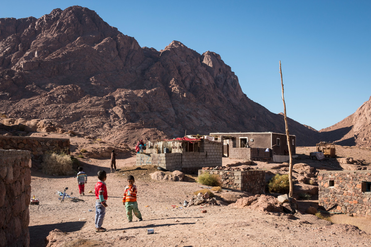 Bedouin homes lay nestled in a dry wadi in Egypt's South Sinai. The ground in the region is hard and rocky, unable to absorb water. As Egypt's climate changes, heavy rainfall is becoming more and more common, bringing dangerous flash floods with it. (Photo: Nicholas Linn)