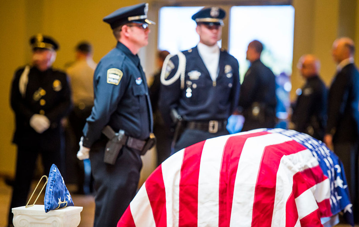 The casket of Garrett Swasey, the 44-year-old University of Colorado at Colorado Springs police officer and six-year veteran of the department. Swasey was killed November 27, 2015, after responding to a shooting at a Colorado Springs Planned Parenthood. (Photo: Stacie Scott-Pool/Getty Images)