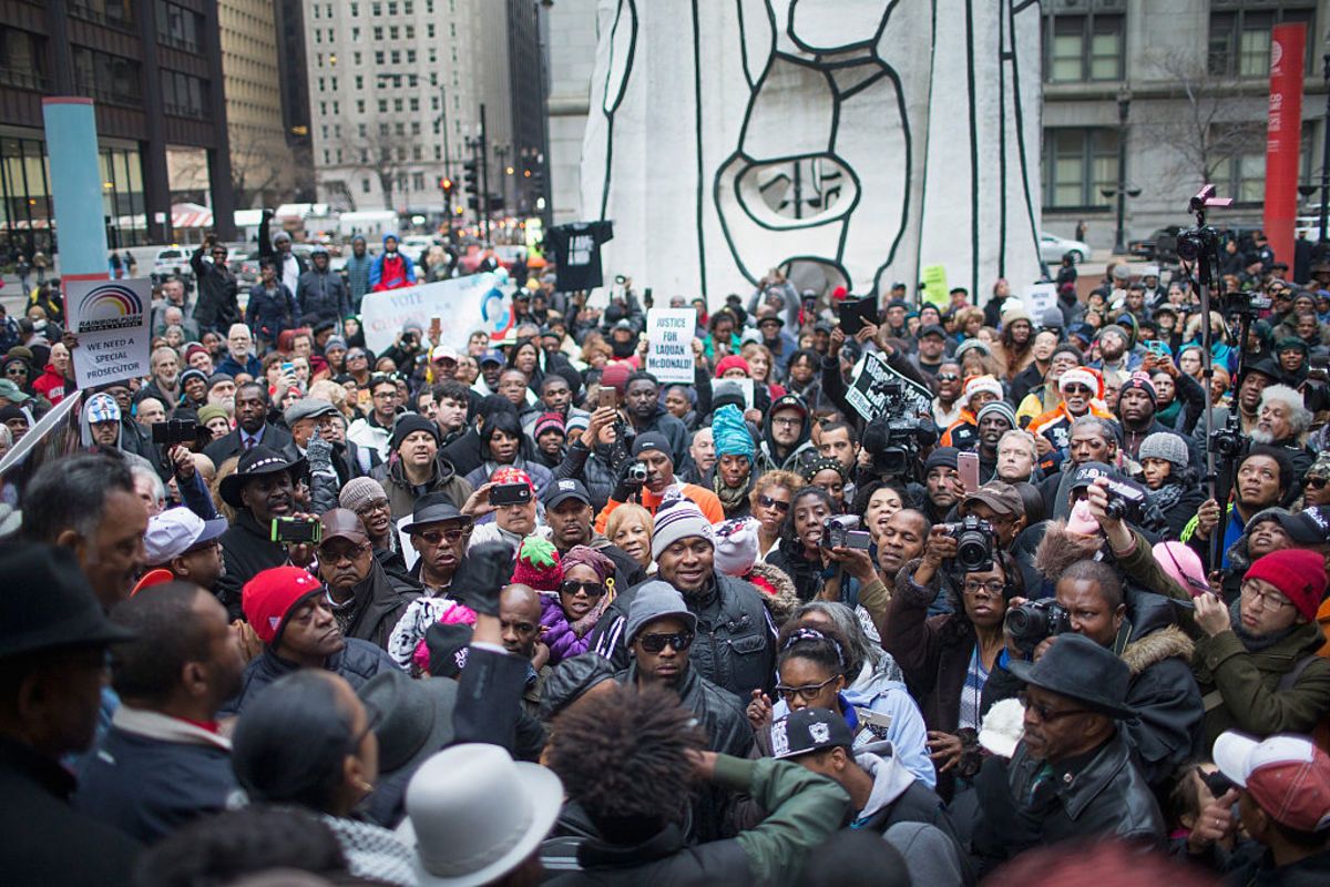 Demonstrators rally at the Thompson Center following a march through downtown to protest the death of Laquan McDonald and the alleged cover-up that followed on December 6, 2015, in Chicago, Illinois. (Photo: Scott Olson/Getty Images)