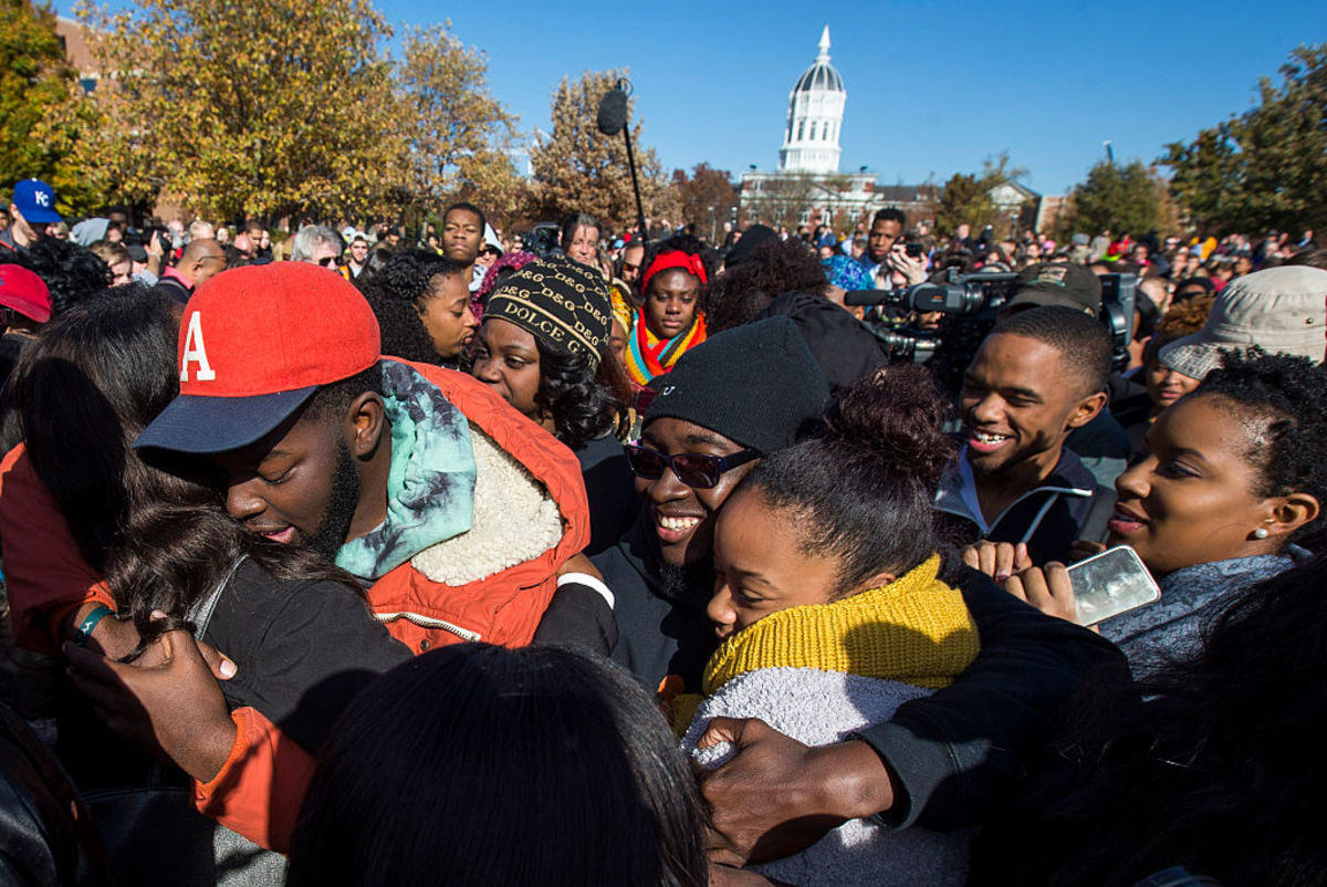 Protesters celebrate after the resignation resignation of University of Missouri President Timothy M. Wolfe on November 9, 2015. (Photo: Brian Davidson/Getty Images)