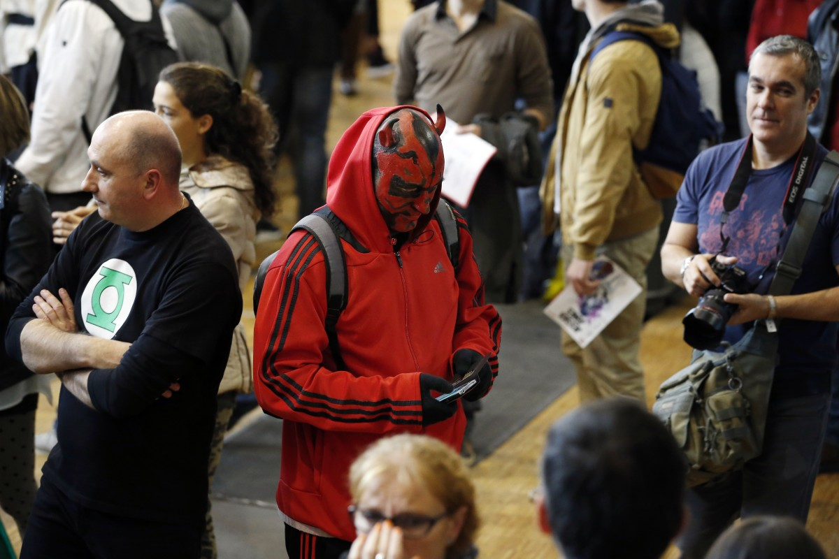 A man dressed up as Darth Maul looks at his phone, during the first Comic Con convention at the Grande Halle de la Villette, on October 23, 2015, in Paris. (Photo: Patrick Kovarik/AFP/Getty Images)