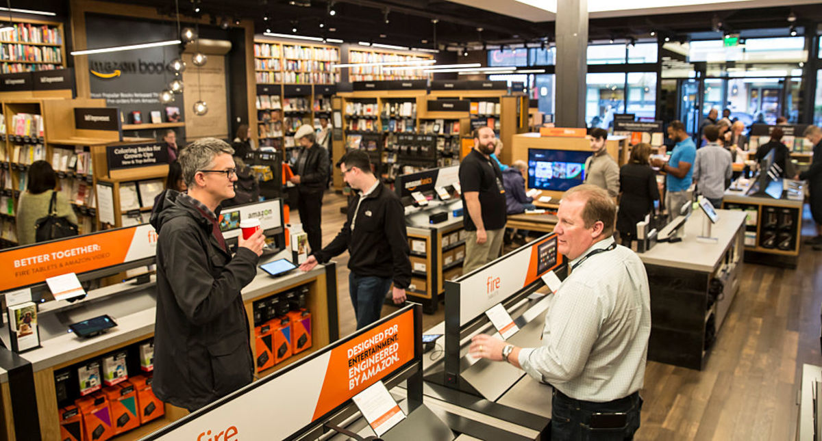 Customers browse books and other Amazon products at the newly-opened Amazon Books store on November 4, 2015, in Seattle, Washington. (Photo: Stephen Brashear/Getty Images)