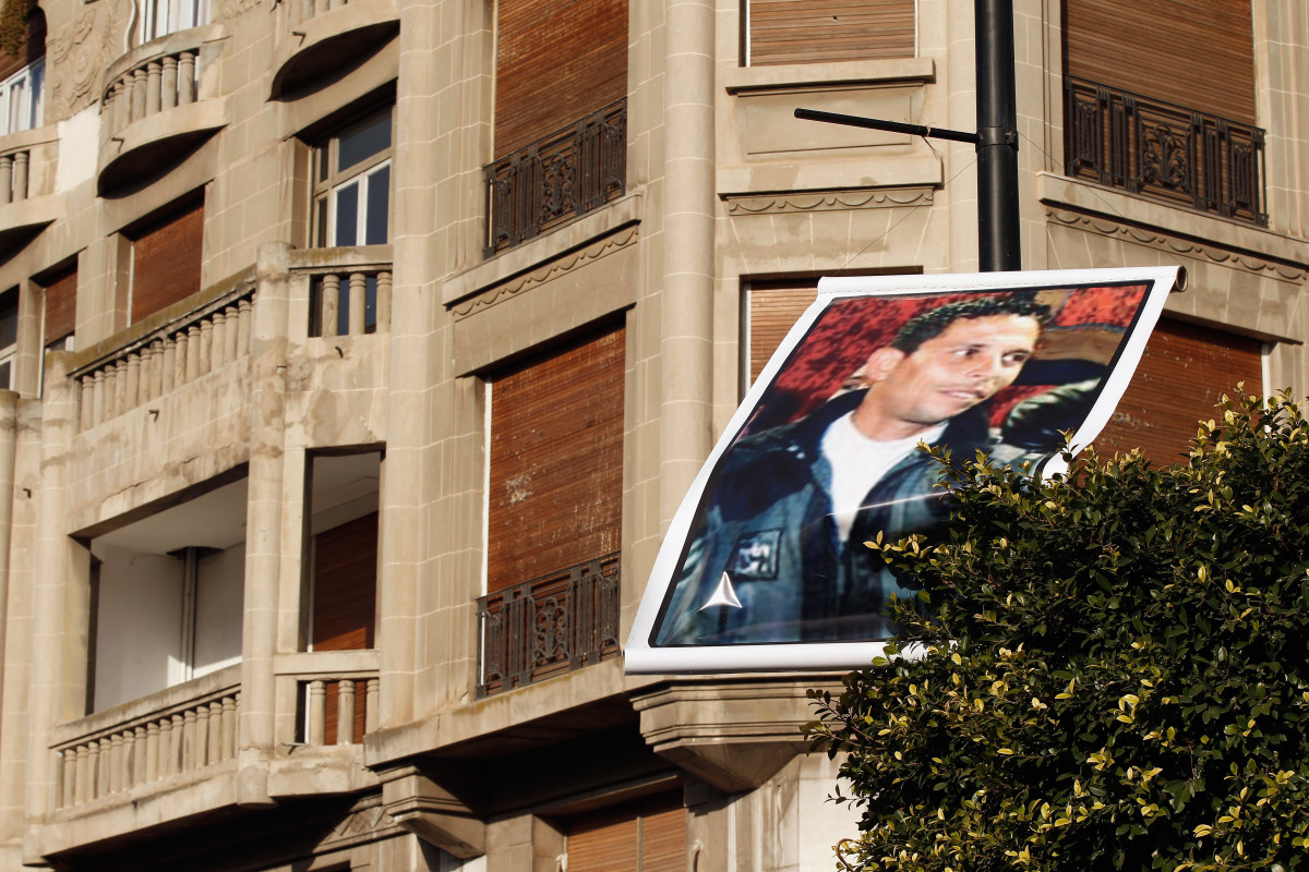 A portrait of Mohamed Bouazizi, who has become a hero in Tunisia ever since he doused himself in petrol and set himself alight, is displayed from a post in Avenue Bourghiba on January 23, 2011, in Tunis, Tunisia. (Photo: Christopher Furlong/Getty Images)