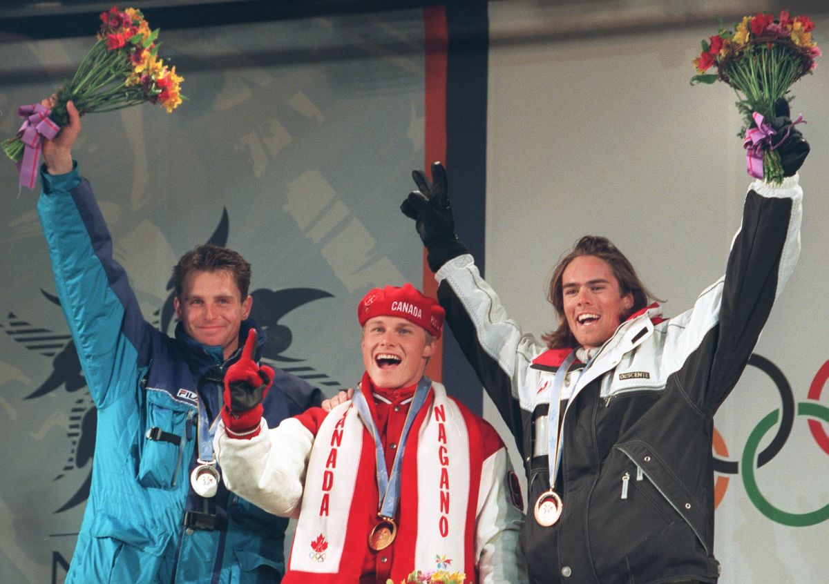 Winners of the men's giant slalom celebrate on the podium in Nagano, Japan, in February 1998. The medals were the first ever awarded for Olympic snowboarding. (Photo: Kazuhiro Nogi/AFP/Getty Images)
