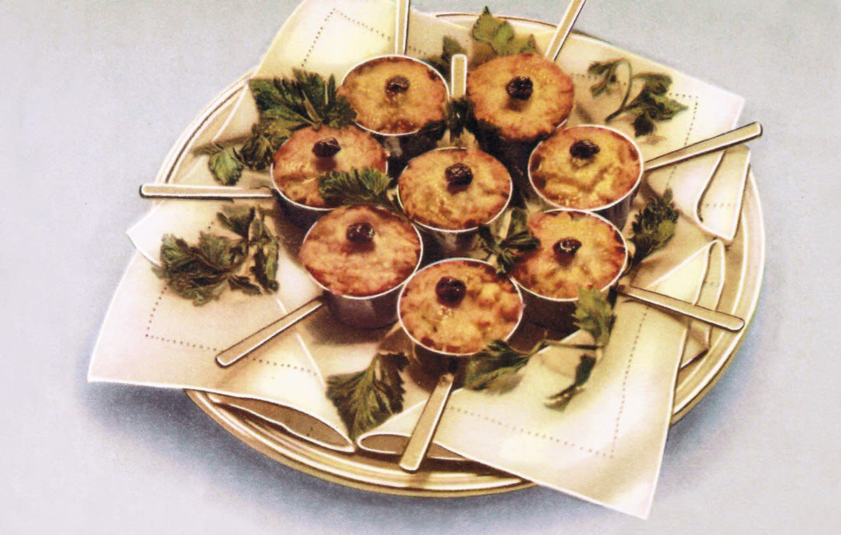 One of the most popular hors d'oeuvres of the Soviet era, Gribni Julienne, is baked individually in cocottes. (Illustration: CCCP Cook Book)