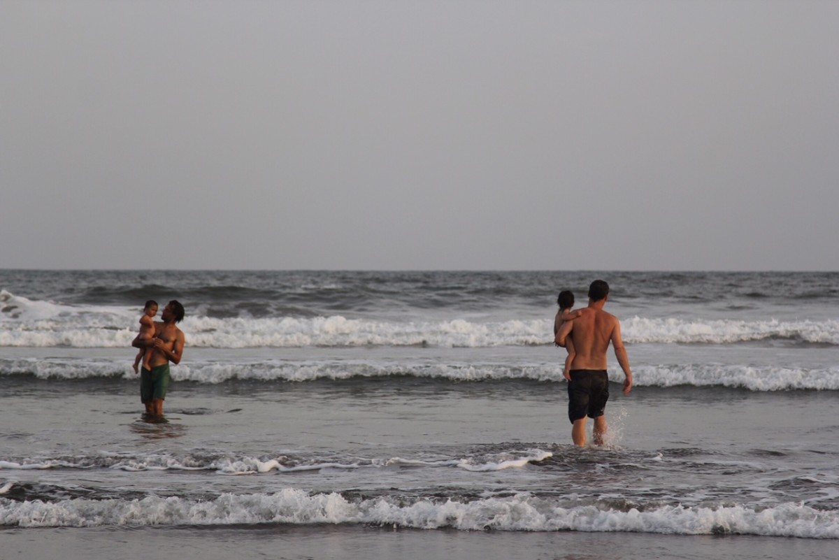 Luke and Veda (left) and Zach and Nami out for an afternoon splash in the El Cuco beach break. (Photo: Jeff Den Broeder)
