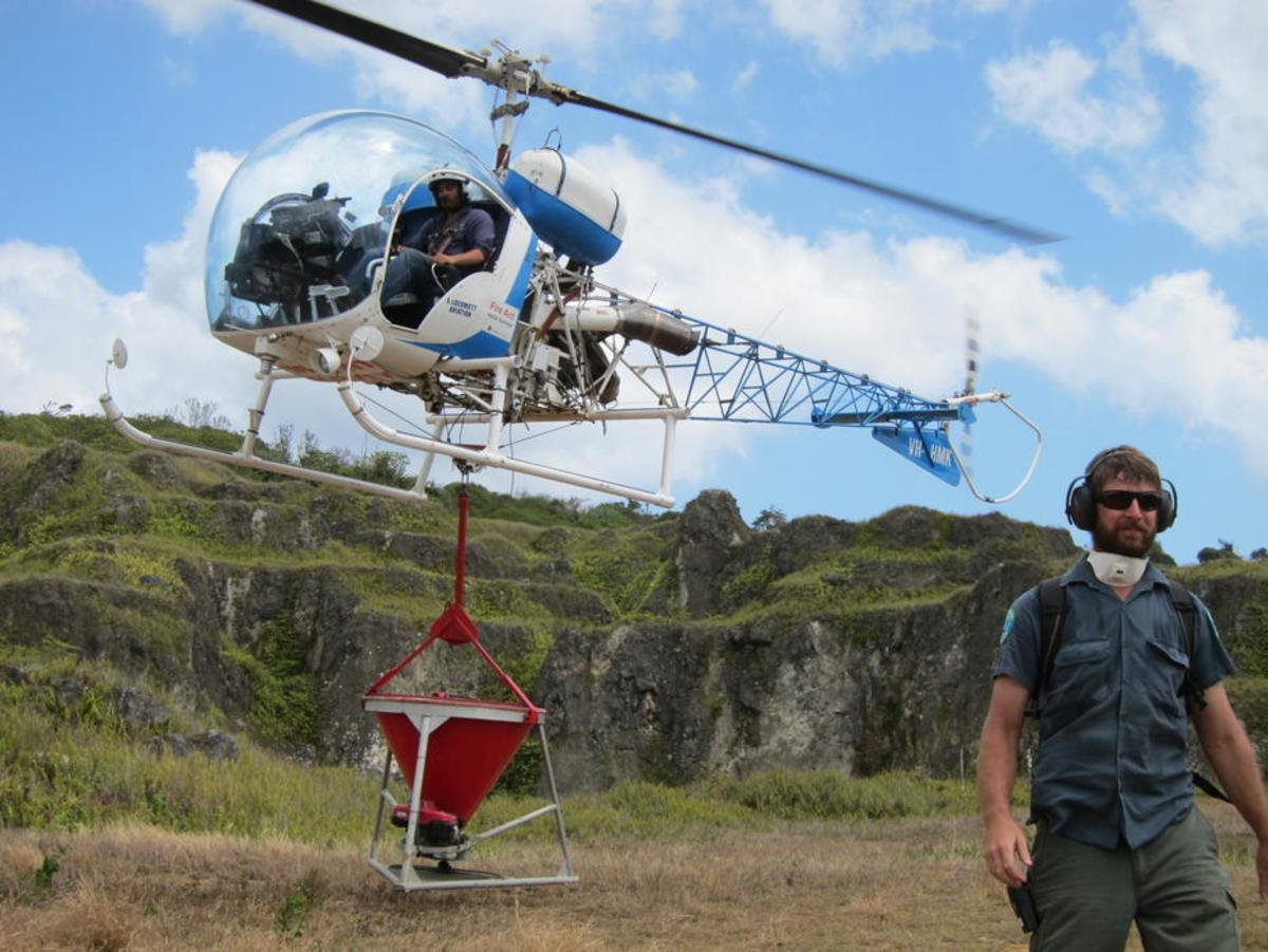 Park officials deliver AntOff via helicopter. (Photo: CINP)