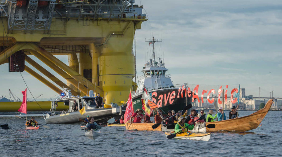 Kayaktivists paddle in front of Shell's oil rig in Seattle's Elliott Bay in June. (Photo: Jeff Dunnicliff/Backbone Campaign)