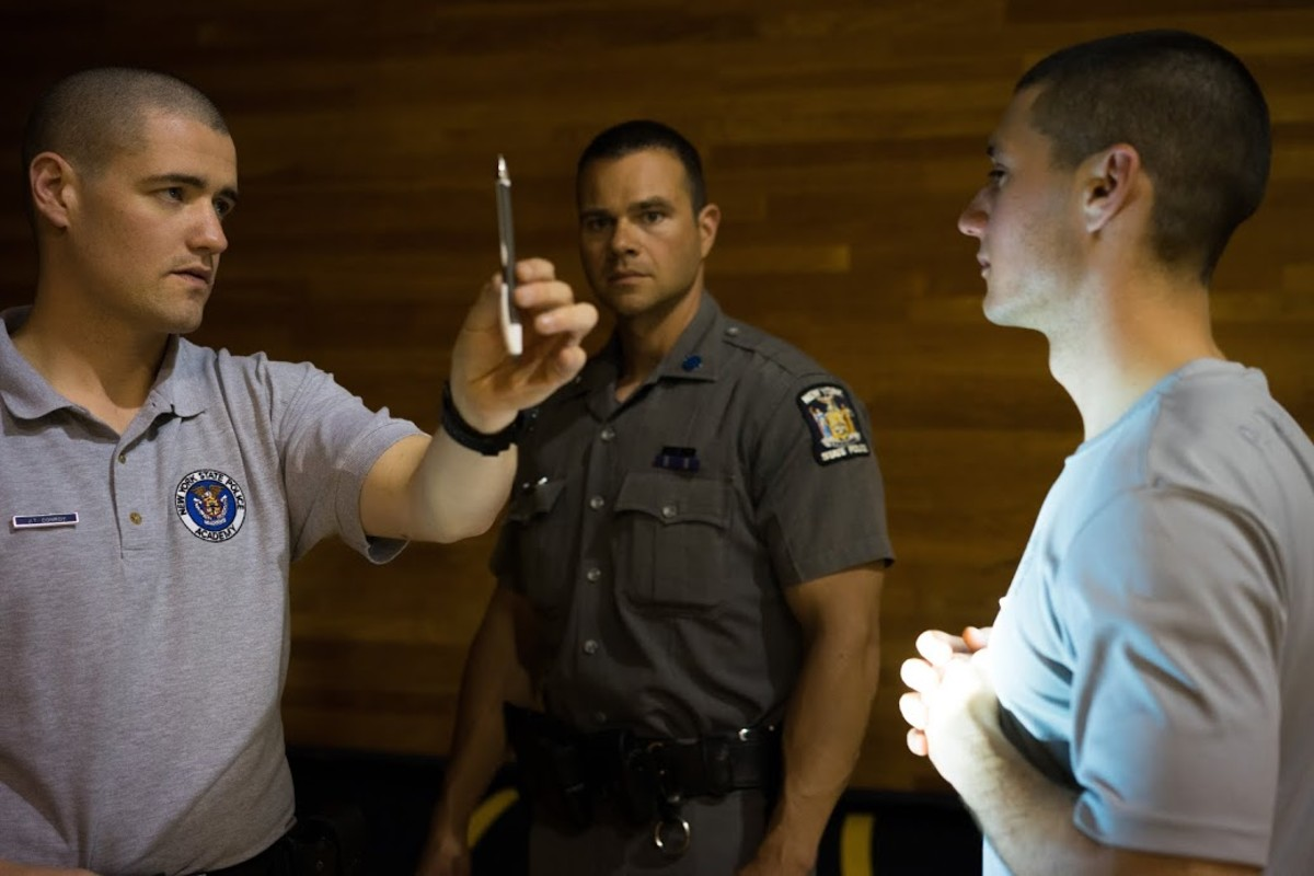 Off the Paddy Wagon: A future officer watches for involuntary jerking of the eyes as he administers one part of a three-test battery meant to determine whether a drunk-seeming driver should be detained. (Photo: John Stillman)