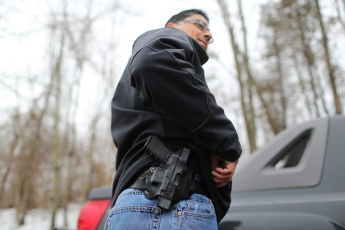 A gun owner displays his pistol at a shooting range in Wallingford, Connecticut. (Photo: Spencer Platt/Getty Images)
