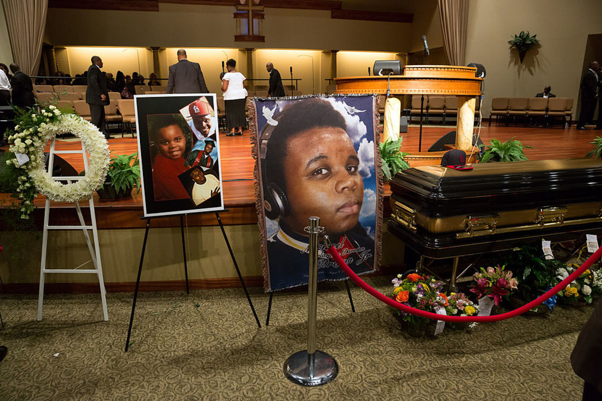 Photos surround the casket of Michael Brown inside Friendly Temple Missionary Baptist Church awaiting the start of his funeral on August 25, 2014, in St. Louis Missouri. (Photo: Richard Perry-Pool/Getty Images)