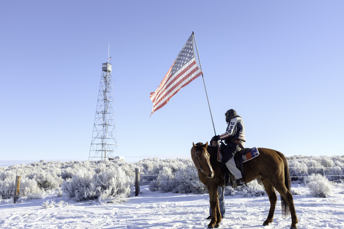 Occupier Duane Ehmer and his horse Hellboy stand at the entrance to the Malheur National Wildlife Refuge headquarters in Burns, Oregon, on January 15, 2016. (Photo: Rob Kerr/AFP/Getty Images)