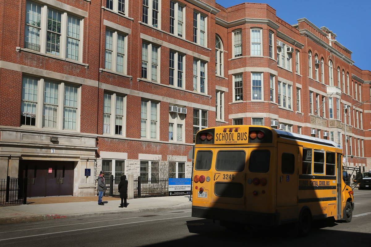 A school bus drives by the Jean De Lafayette Elementary School on March 21, 2013, in Chicago, Illinois. (Photo: Scott Olson/Getty Images)