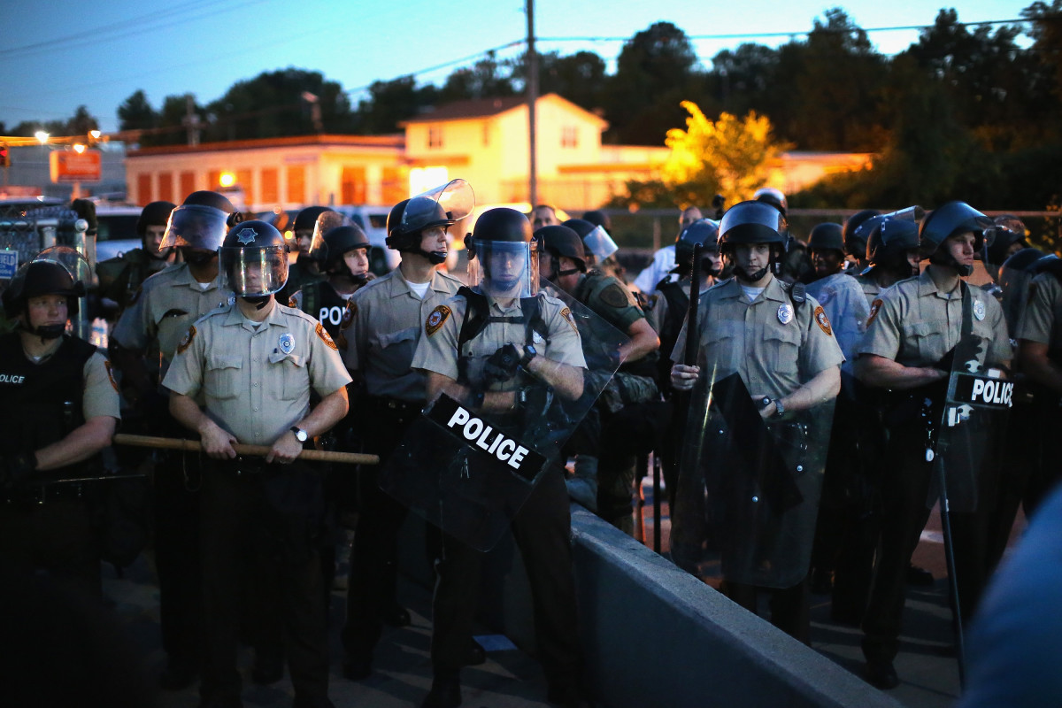 Police stand watch as demonstrators protest the shooting death of teenager Michael Brown on August 13, 2014, in Ferguson, Missouri. (Photo: Scott Olson/Getty Images)