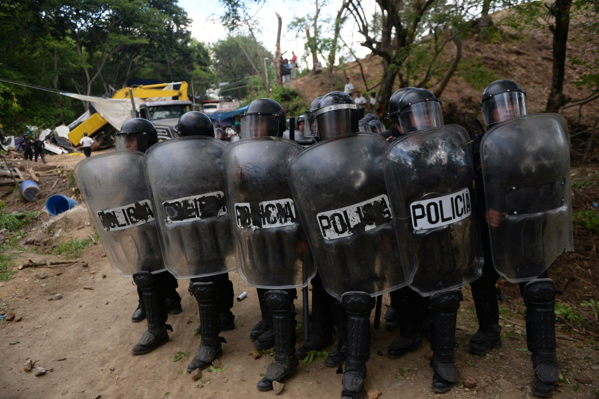 Riot police officers clash with protesters during the eviction of about  300 people who were blocking the entrance of a mining company outside of Guatemala City on May 23, 2014. (Photo: Johan Ordonez/AFP/Getty Images)
