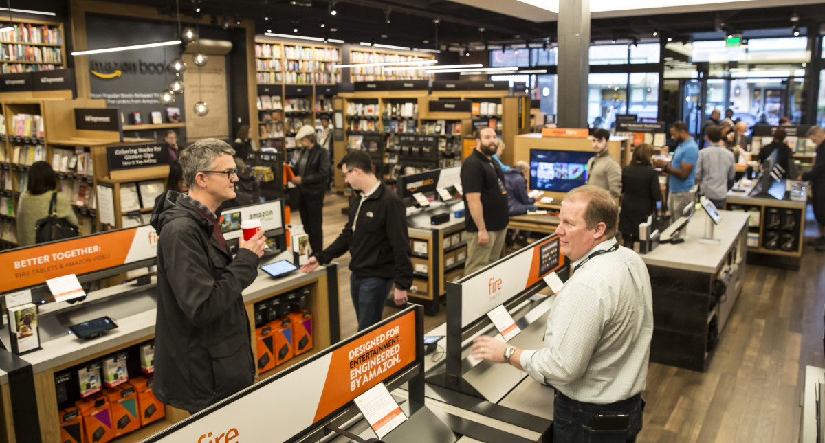 Customers browse books and other products at the newly opened Amazon Books store on November 4, 2015, in Seattle, Washington. (Photo: Stephen Brashear/Getty Images)