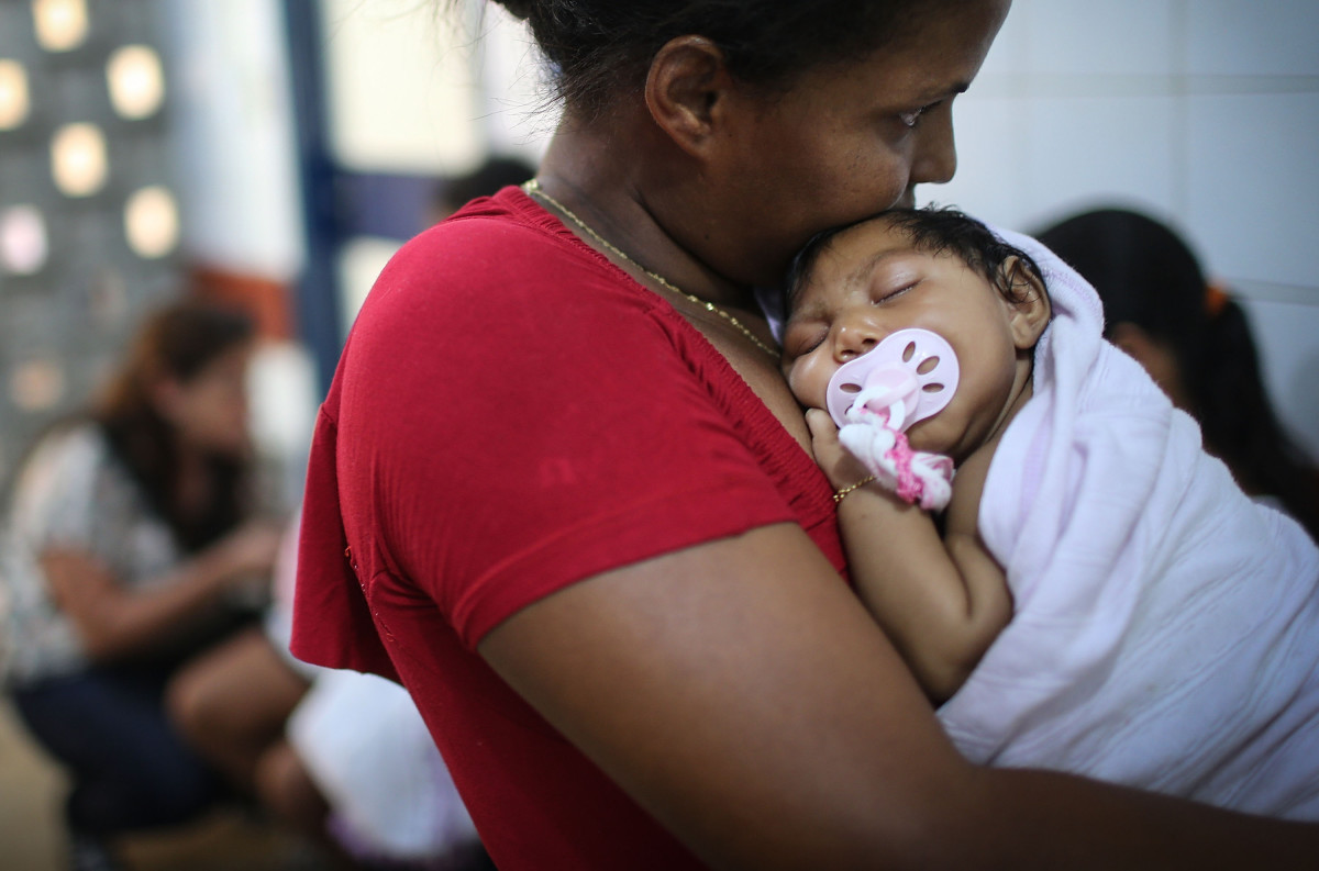 Grandmother Ivalda Caetano holds Ludmilla Hadassa Dias de Vasconcelos, who has microcephaly, at Oswald Cruz hospital on January 26, 2016, in Recife, Brazil. (Photo: Mario Tama/Getty Images)