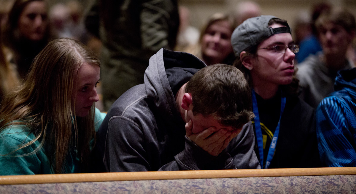 People gather and pray at Center Point Church following a mass shooting on February 21, 2016, in Kalamazoo, Michigan. (Photo: Tasos Katopodis/Getty Images)