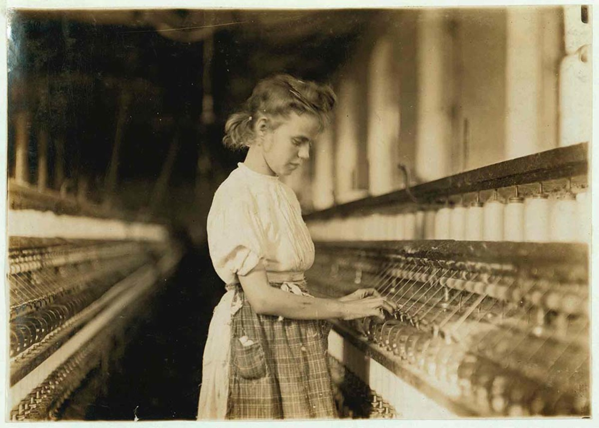 Girl working in a mill in Cherryville, North Carolina. (Photo: Lewis W. Hine/Library of Congress)