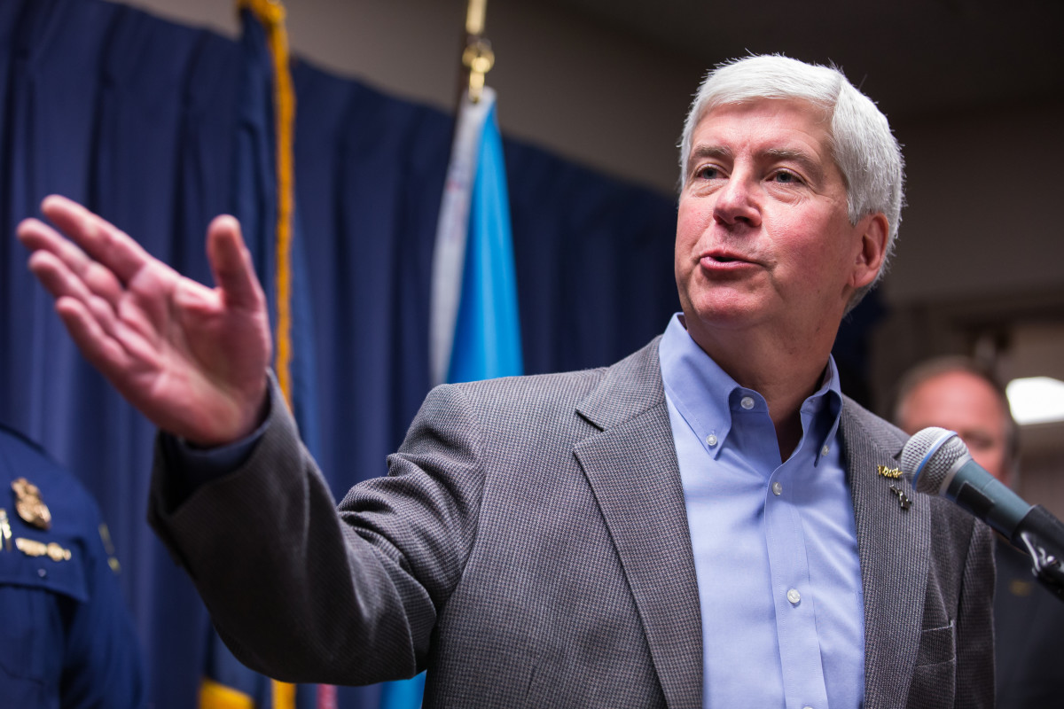 One of Michigan Governor Rick Snyder's first actions was to sign legislation greatly enhancing the powers of emergency managers, provoking backlash from activists who viewed the new law as inherently undemocratic. (Photo: Brett Carlsen/Getty Images)