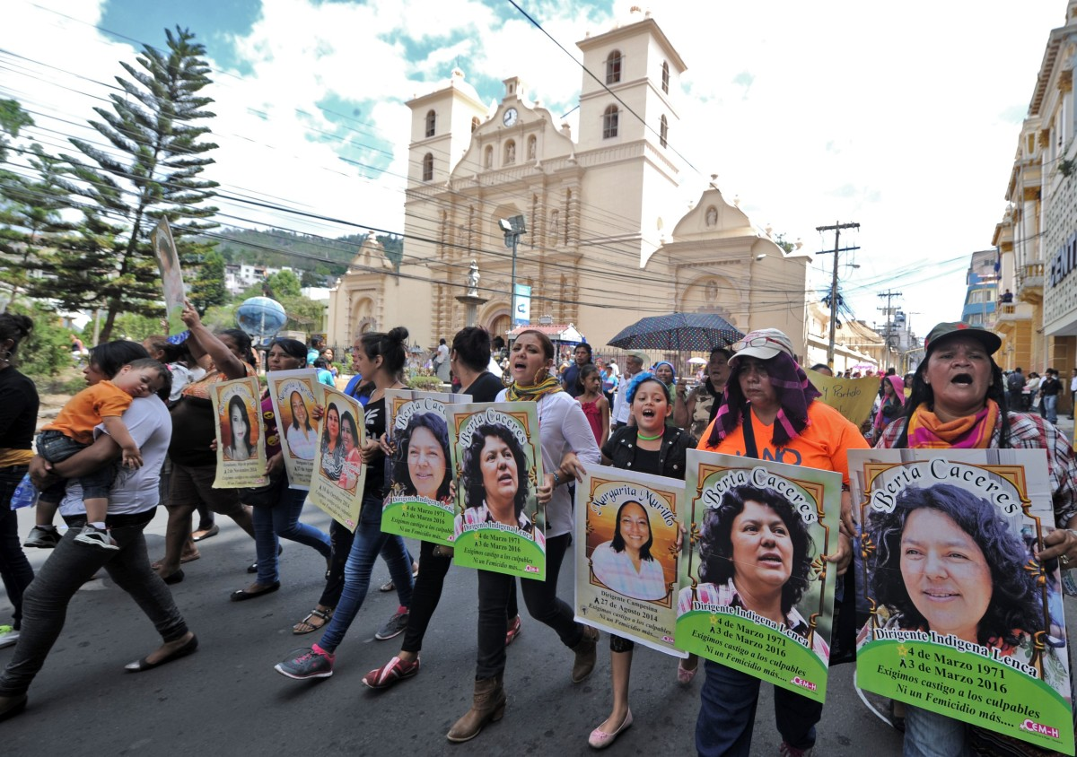 Posters of slain Honduran environmentalist Berta Cáceres are carried during a demonstration in Tegucigalpa, Honduras. (Photo: Orlando Sierra/AFP/Getty Images)