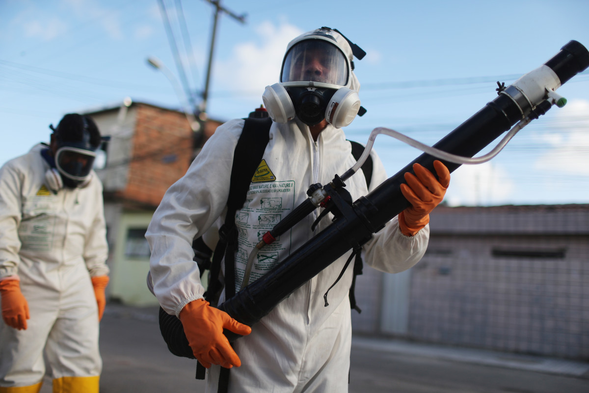 Health workers fumigate in an attempt to eradicate the mosquito which transmits the Zika virus on January 28, 2016, in Recife, Brazil. (Photo: Mario Tama/Getty Images)