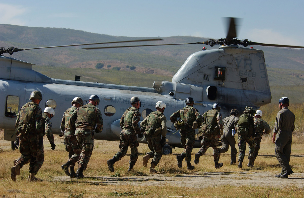 U.S. Marines run to board an HC-46 Sea Knight helicopter during training exercises at Camp Pendleton, California. (Photo: David McNew/Getty Images)