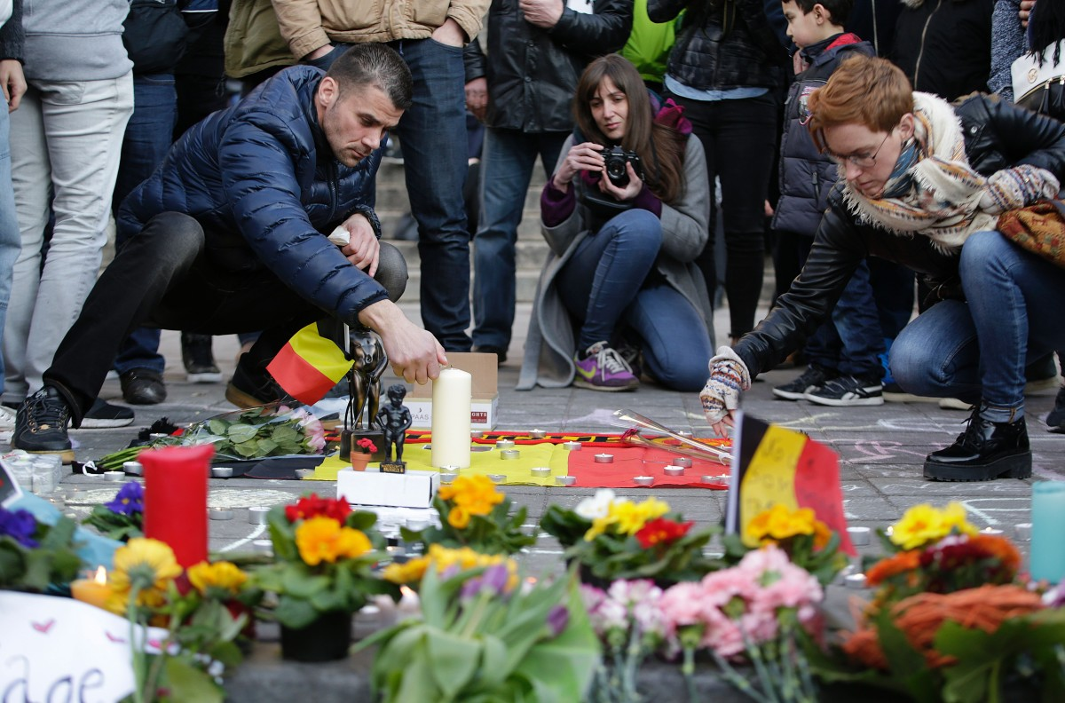 People light candles at a makeshift memorial at Place de la Bourse following attacks in Brussels on March 22, 2016. (Photo: Kenzo Tribouillard/AFP/Getty Images)
