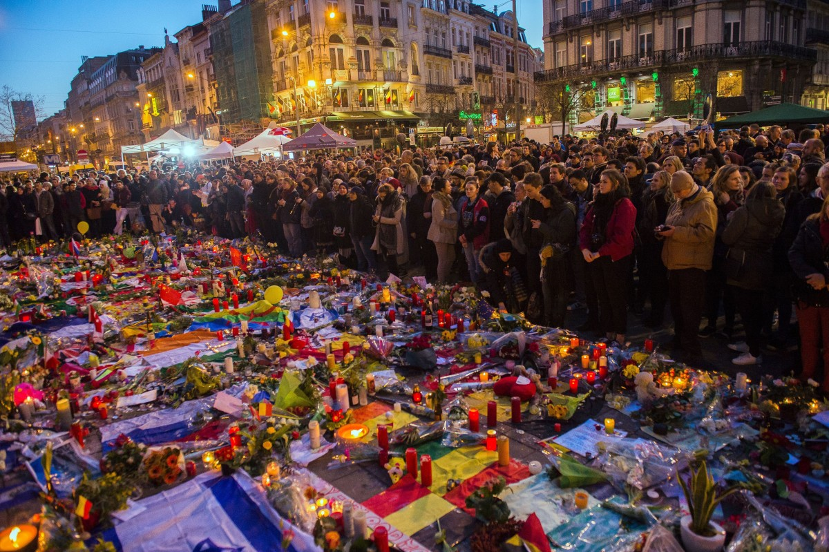 A picture taken on March 25, 2016, shows people gathering at a makeshift  memorial in tribute to the victims of the Brussels terror attacks.        (Photo: Laurie Dieffembacq/AFP/Getty Images)