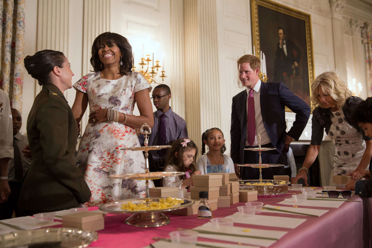 Prince Harry, Michelle Obama, and Jill Biden helping children create Mother's Day cards at the White House. (Photo: Public Domain)