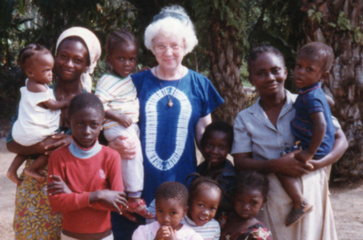 Sister Agnes Mueller meets with women and their families outside the church in Gardnersville, Liberia, in 1992. (Photo: Adorers of the Blood of Christ)