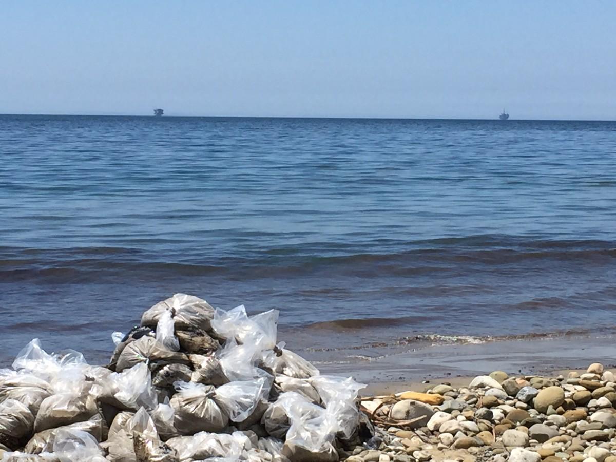 Bagged oil on Refugio Beach, in Santa Barbara County. (Photo: Max Ufberg/Pacific Standard)