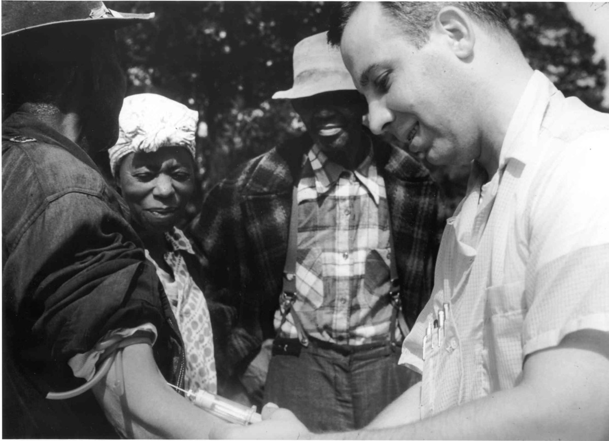 John Charles Cutler, who led the experiments in Guatemala, also participated in the Tuskegee syphilis experiment. Here, an unnamed doctor draws blood from one of the Tuskegee test subjects. (Photo: Public Domain)