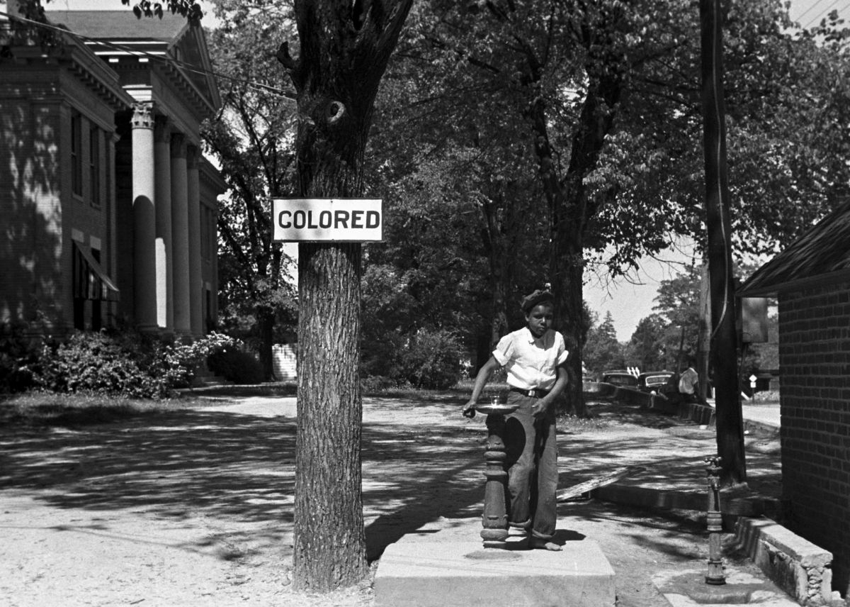 "An African-American kid at a ""colored"" drinking fountain on a courthouse lawn in Halifax, North Carolina, in 1938. (Photo: Public Domain)"
