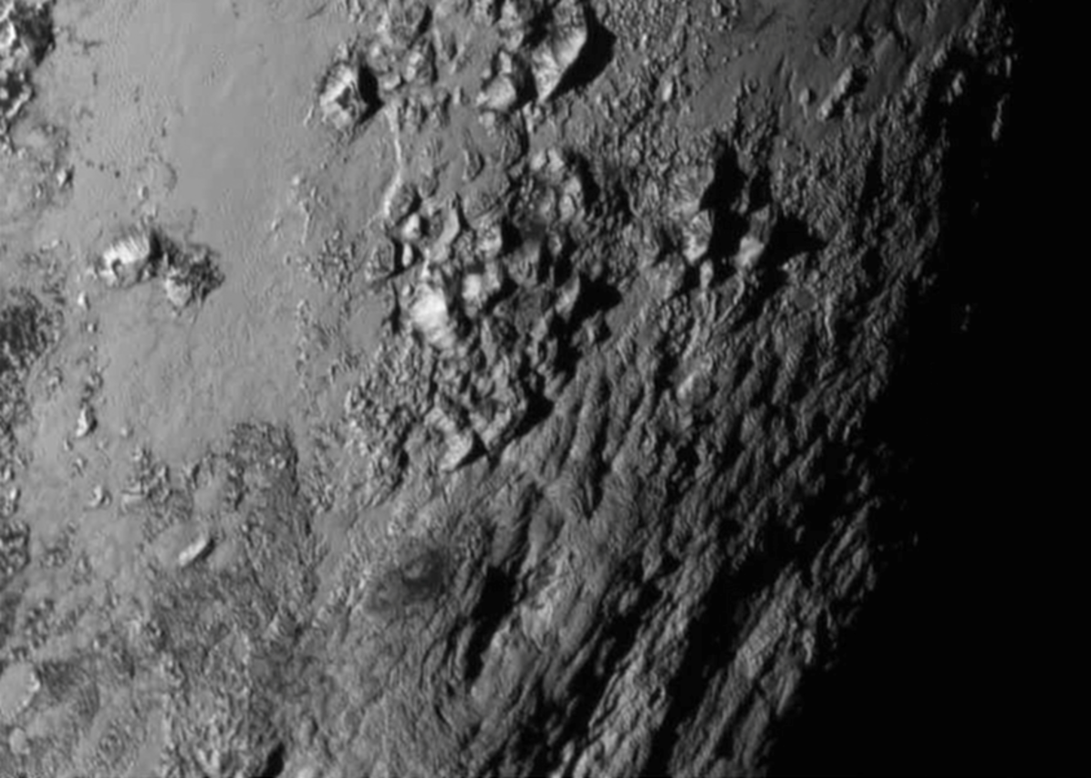 This new close-up shows mountains on Pluto's surface. (Photo: JHU/NASA)