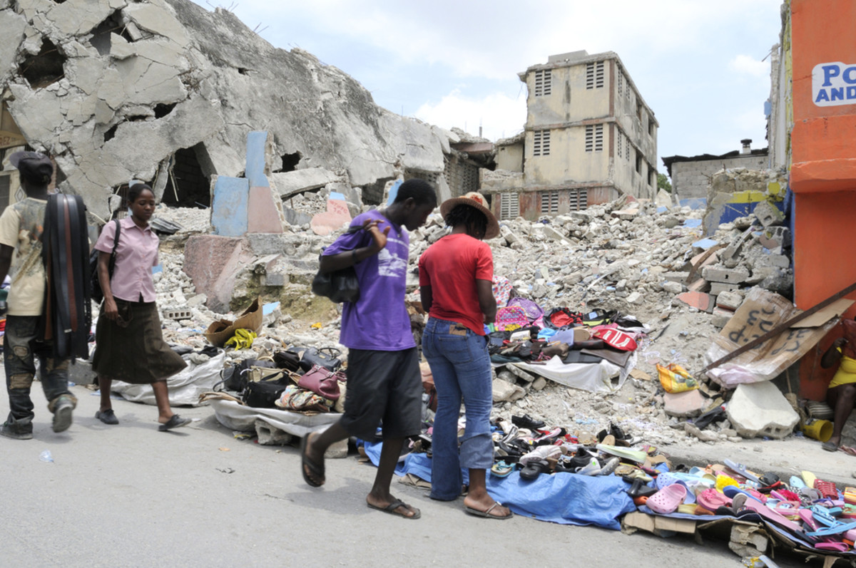 People buying and selling stuffs in front of a collapsed building in   Port-Au-Prince, Haiti, on August 21,  2010. (Photo: arindambanerjee/Shutterstock)