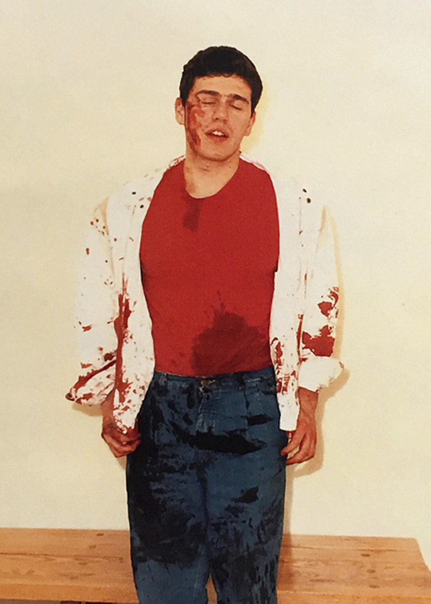 "This photo, taken at the police department shortly after the  incident, shows Toumbis spattered with Slazyk's blood. Toumbis later  described the weapon he used as a ""pocket knife."""