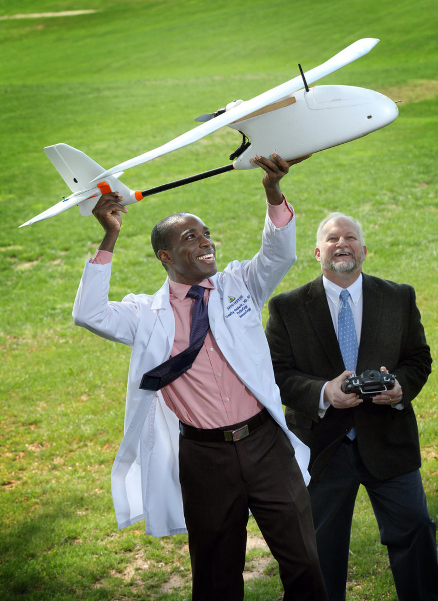 Pathologist Timothy Amukele and engineer Robert Chalmers test how blood samples fare when flown in a drone. (Photo: Johns Hopkins Medicine)