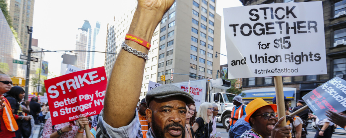 Fast-food workers and their supporters march in New York. (Photo: a katz/Shutterstock)
